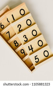 Wood montessori material, class at school with math bars and numbers