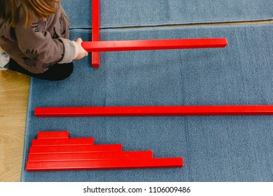 Wood montessori material, class at school with math bars,hands