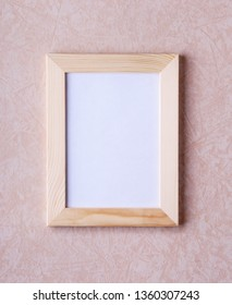Wood narrow photo frame with mock up space on wall.