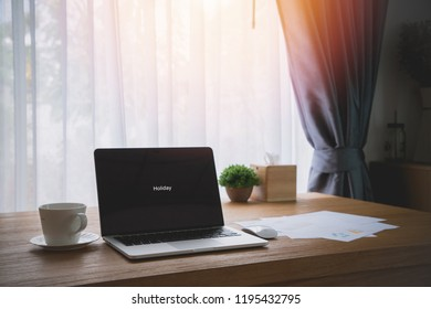 wood office table with blank screen on laptop in office room. vintage picture style.