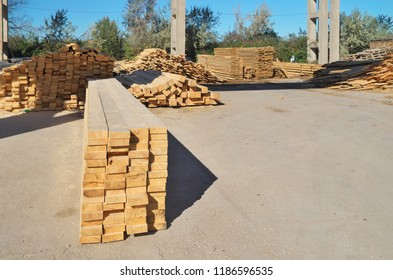 Wood in an outdoor pine wood warehouse. Building industry scene.