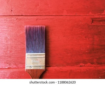 Wood Paint brush over the red wooden background