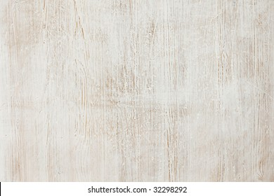Wood painted white, worn and scratched background texture