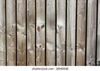 Wood panel fence.