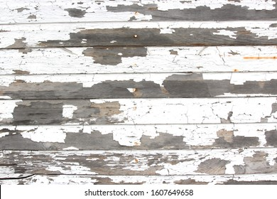 Wood panel texture with white chipping and peeling paint
