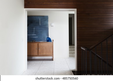 Wood panel wall detail and entry foyer in mid century modern Australian home