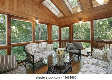 Wood paneled porch in suburban home with skylights