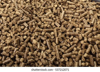 Wood pellets in the background.
