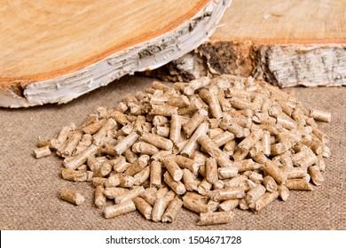 Wood pellets close up .Wooden pellet bio fuel. Biomass Pellets - cheap energy. The cat litter.