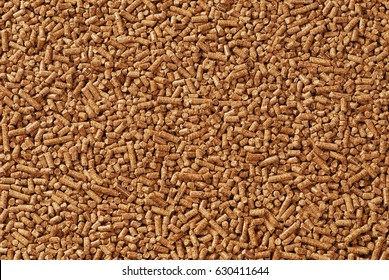 Wood pellets - close-up, background, cheap energy.