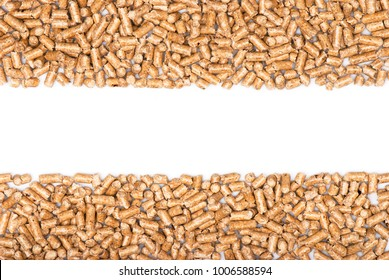 Wood pellets. Wood pellets on a blank (white) background, arranged on both top and bottom side, with copy space. Top view.