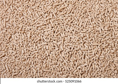 Wood Pellets. Solid Wood Pellets Background close up. Pressed Pellet made of Wood. Ecology and Heating season, heat and Heating House