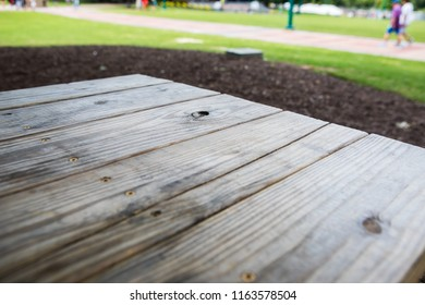 A wood picnic table and a lawn in a park in Atlanta, Georgia