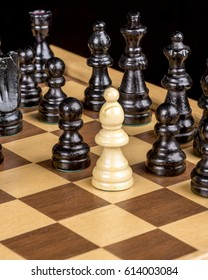 Wood pieces of a game of chess on a board