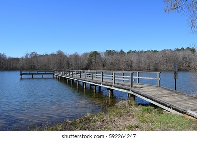 Wood pier in a lake in Wall Doxey State Park, Mississippi