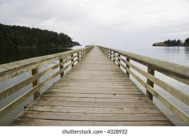 Wood pier near Deception Pass near Seattle Washington going out towards the ocean
