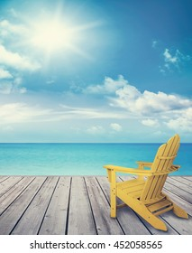 Wood pier with sun chair and ocean in background