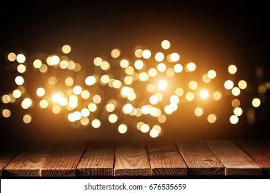 wood plank and glowing lights background