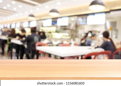 wood plank on blur canteen dining hall room, empty wood table floors on a lot of people are eating food in university canteen blur background, wood table board empty on blur cafe or cafeteria canteen