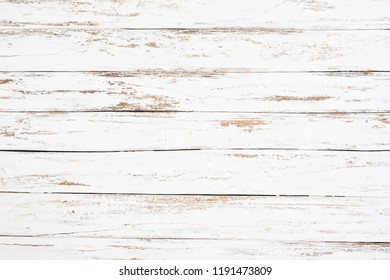 Wood plank painted in white weathered and old. Vintage and rustic white wooden background.