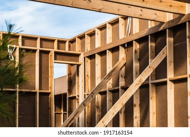 Wood planks s for walls and beams in the construction of a new sustainable wooden house.