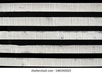 Wood planks, white on black.