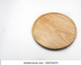 wood plate on cloth table