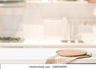 Wood plate on white table in kitchen room background and copy spce for productor food montage
