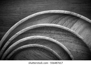 Wood plates stacked on wooden table,black and white