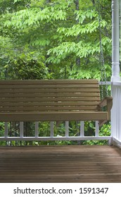 Wood Porch Swing in a wooded setting
