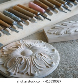 Wood processing. Joinery work. wood carving. the carving object with pattern, chisels for carving close up. small depth of field. use as background