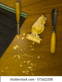 Wood processing. Joinery work. wood carving. a wood carvings, tools on the wooden background close up. use as background