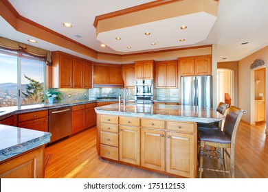 Wood rich kitchen room with hardwood floor and coffered ceiling