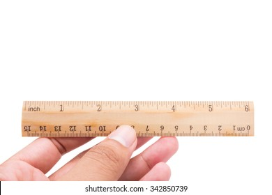 Wood ruler with hand isolated
