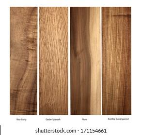 wood samples of Koa-Curly,Cedar-Spanish,Plum and Arariba-Canarywood on a white background