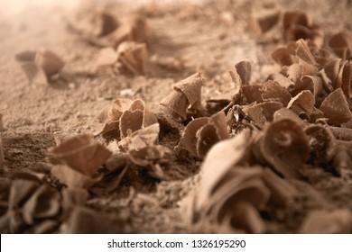 Wood sawdust closeup. Sawdust floor texture. Milling machine. Sawdust texture, background of brown sawdust