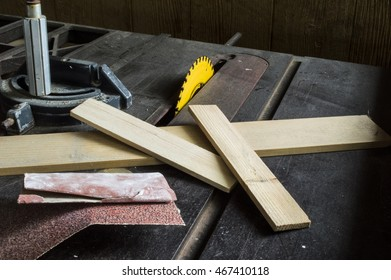 Wood scraps and sand paper on a table saw