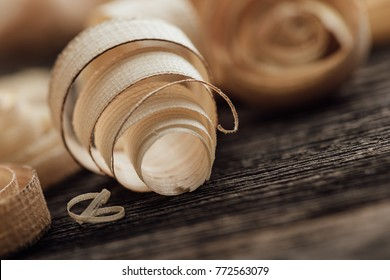 Wood shavings on the carpenter's workbench close up: woodworking and carpentry concept