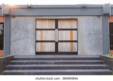 wood sheet door on a polished concrete building.