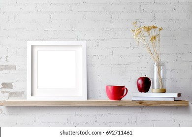 Wood shelf with blank white frame and coffee.Blank screen for products or graphic montage.