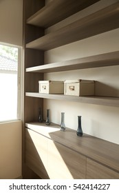 wood shelves with different home related objects and boxes with sun light