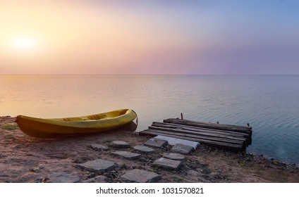 wood shore and kayak boat on beach island in sunset time for relax landscape