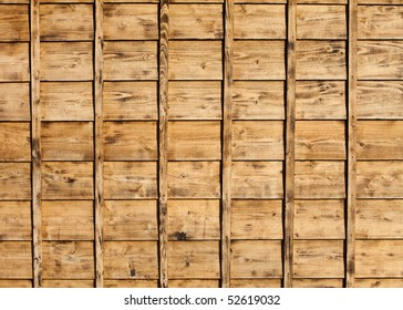 The wood siding of an old style Japanese house.  The wood is new but had been burned to give the appearance of being older.