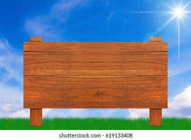 Wood sign on grass and blue sky background, summer and spring concept