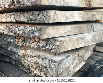 Wood slabs stacked for air drying