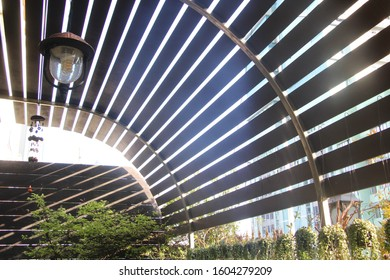 Wood slat roof or wood blinds for sunshade.