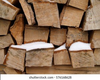 wood with snow in winter