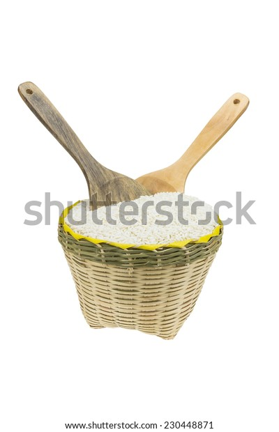Wood spoon and bamboo basket  isolated on white background