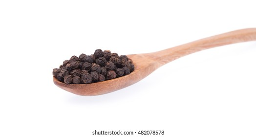 wood spoon of black pepper isolated on white background