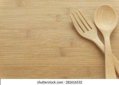 wood  spoon and wood fork on wood background